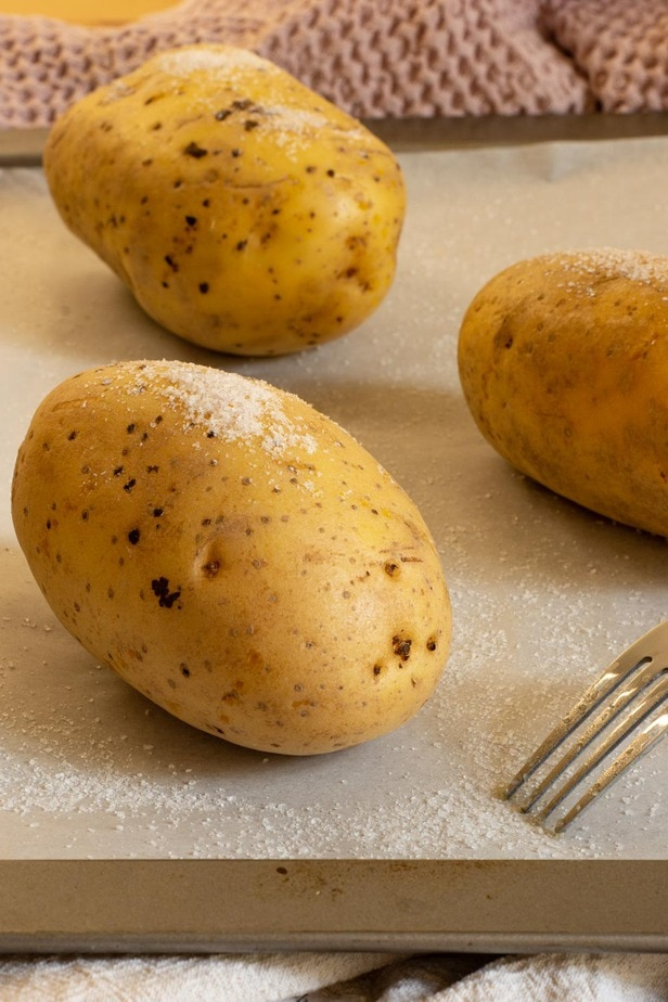 salted potatoes on a baking tray