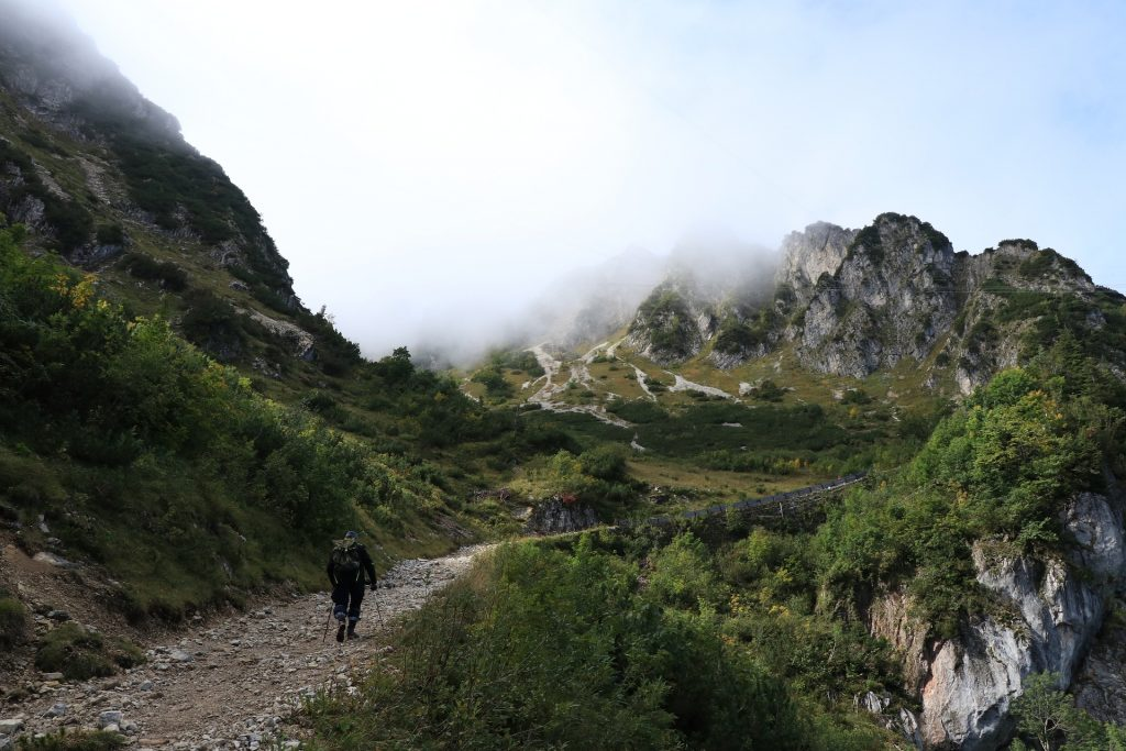 Hiking with vegan hiking boots in the mountains